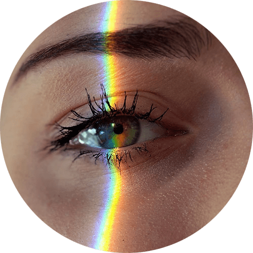 Image of a close-up of a green eyeball with a rainbow going across the person's face. In EMDR therapy in Louisville, CO, bilateral stimulation helps the brain connect. | 80305 | 80403