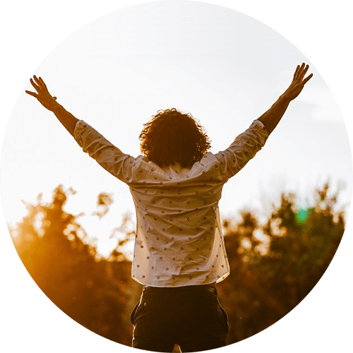 Image of a man holding up his hands to the sky. This image depicts how sexual assault survivors feel after working with a sexual assault therapist in Louisville, CO. 80027   80025