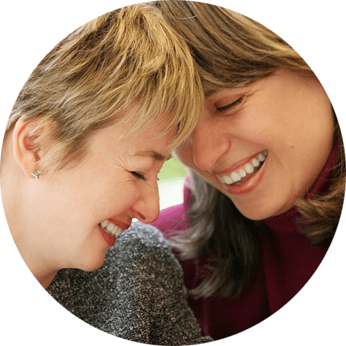Image of two women holding each other and smiling. Premarital counseling in Louisville, CO is available to straight and same sex couples. A premarital counselor in Louisville, CO can help couples of all kinds.   80027   80025