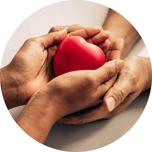 Image of two hands holding a red heart stone. This image depicts what working with a therapist in Louisville, CO is like in therapy for life transitions. Going through big life changes can be hard, but a therapist can help.   80304   80303   80301