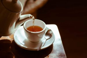 Cup of tea being poured on a table. A Louisville, CO therapist shares about the tough life transitions in Boulder County, CO including co-parenting tips in Louisville, CO and beyond here.